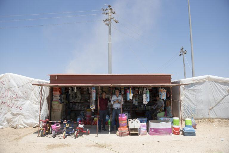 Yazidi shopkeeper at IDP camp in Iraq