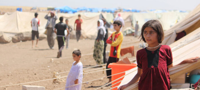 Yazidi refugees, including several children, go about their lives in Nawrouz refugee camp, approximately 40 kilometres from the Syrian border with Iraq. UNICEF/Razan Rashidi