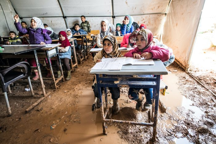 Refugee children attend class in Azez, Syria
